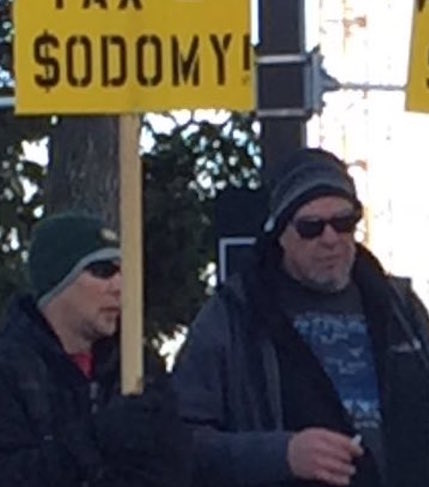 Closeup on $odomy Sign Men