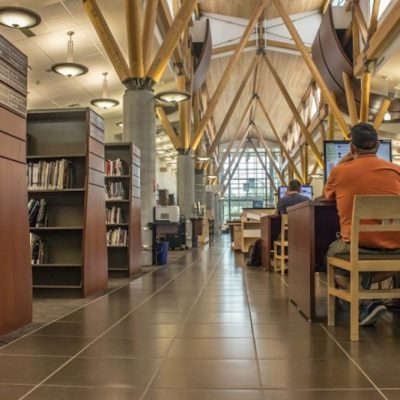 Acknowledging public reaction, Edmonton Public Library drops plan to cut pages' wages, strikes deal with union