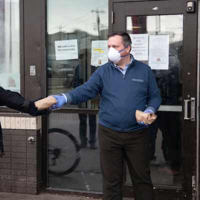 No one should fault Jason Kenney for his Hope Mission photo op — but that N95 mask is another matter